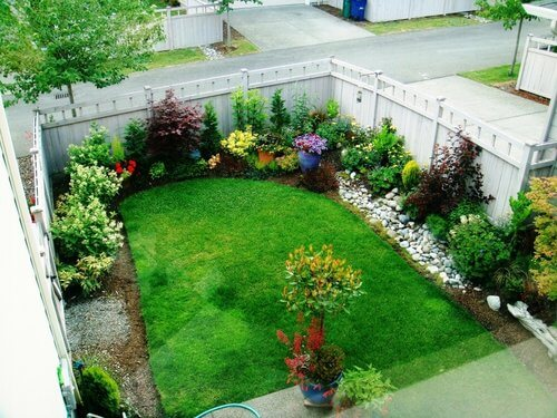 Small backyard garden with zoysia